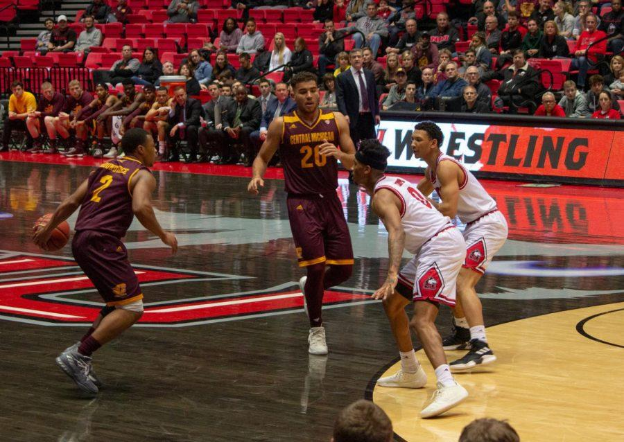 Senior guard Dante Thorpe and first-year guard Trendon Hankerson look to defend Central Michigan senior guard Shawn Roundtree Jr. and junior guard Kevin Mckay during the Huskies 78-69 loss Jan. 15.