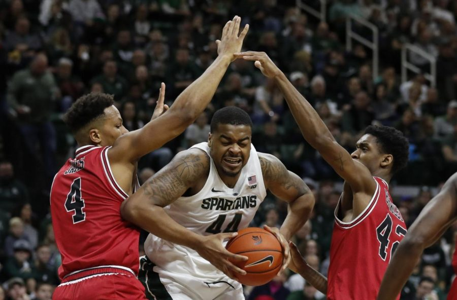 Michigan State forward Nick Ward (44) is double teamed by Northern Illinois forwards Lacey James (4) and Levi Bradley (42) during the second half of an NCAA college basketball game, Saturday, Dec. 29, 2018, in East Lansing, Mich. (AP Photo/Carlos Osorio)