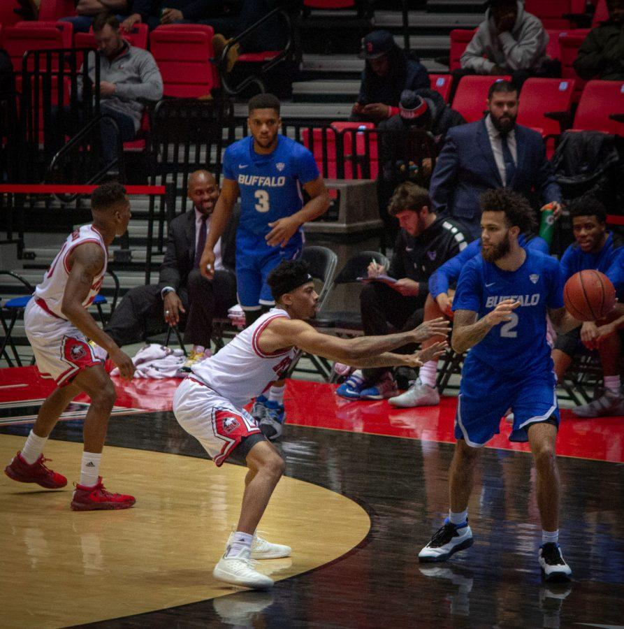Senior guard Dante Thorpe (left) reaches for the ball while defending Buffalo senior guard Jeremy Harris during the Huskies' 77-75 victory Jan. 22.