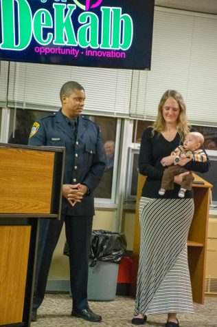 Officer Keunte Mallet and his wife Heather and son before his pinning ceremony for his promotion to sergeant during the Jan. 28 City Council meeting at the DeKalb Municipal Building, 200 S. Fourth St.