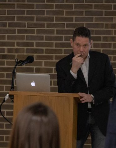 """David J. Gunkel, professor of communication studies and author of """"Robot Rights,"""" holds a book talk and argues if robots should have moral or legal standing Wednesday in the Founders Memorial Library."""