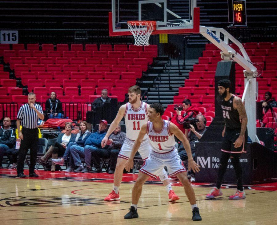 Junior forward Noah McCarty (left) and first-year guard Trendon Hankerson get in defensive position during the Huskies' 71-72 Feb. 5 loss to Ball State.