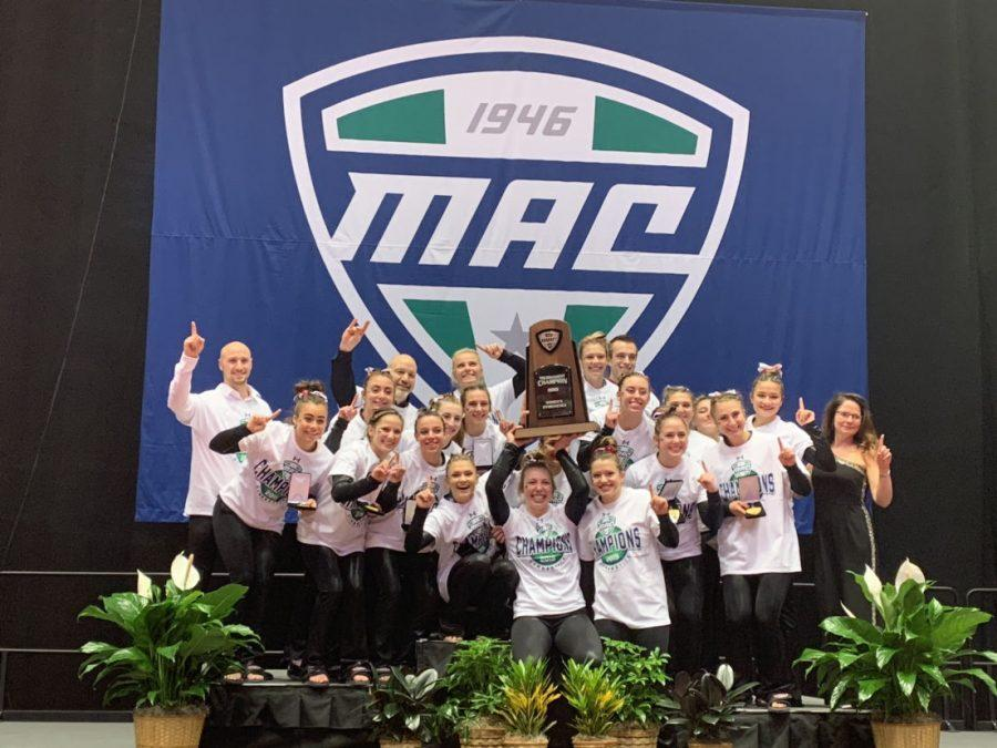 The gymnastics team celebrates after winning the program's first ever Mid-American Conference Championship on March 23.