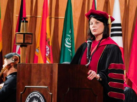NIU President Lisa Freeman speaks during her investiture Friday in the Boutell Memorial Concert Hall of the Music Building, where she accepted the university medallion and mace, symbols of the president's authority and academic designation.