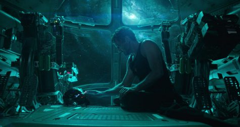 Tony Stark, played by Robert Downey Jr., uses the Iron Man helmet to record himself in