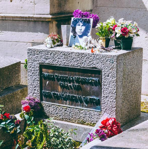 Located in Paris, the grave of Jim Morrison attracts many music fans. Morrison was the frontman of The Doors and died at the age of 27 to become a member of the infamous 27 Club.