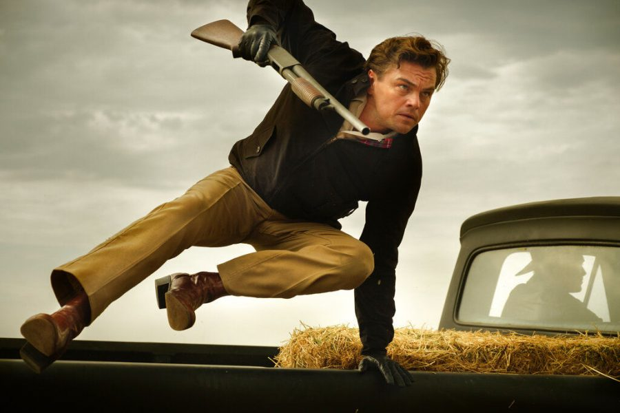 Rick Dalton, played by Leonardo DiCaprio, leaps out of a truck following a shooting in