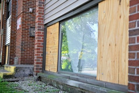 A boarded-up window stands at the condemned 808 Ridge Drive apartments.