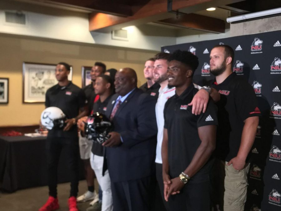 Thomas Hammock (middle) poses for a photo with a few key members of the NIU football team.