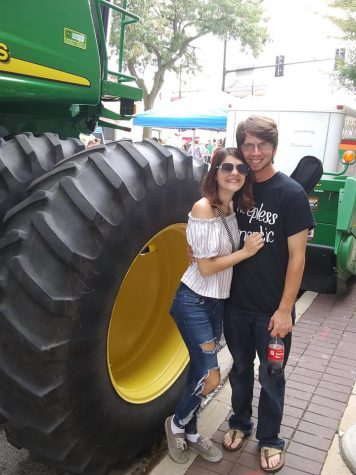 Editor in Chief Sam Malone (left) and Zack Edwards, Chicago Ridge, stand in front of a tractor at the 2018 Corn Fest