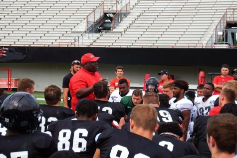 Head coach Thomas Hammock addresses the team during Spring football practice.