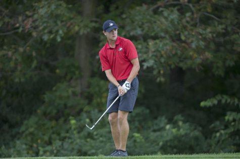 Senior golfer Michael Mattas aims at his target.