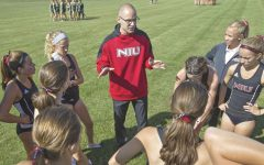 NIU cross country Head Coach Adrian Myers talks to his team in 2019.