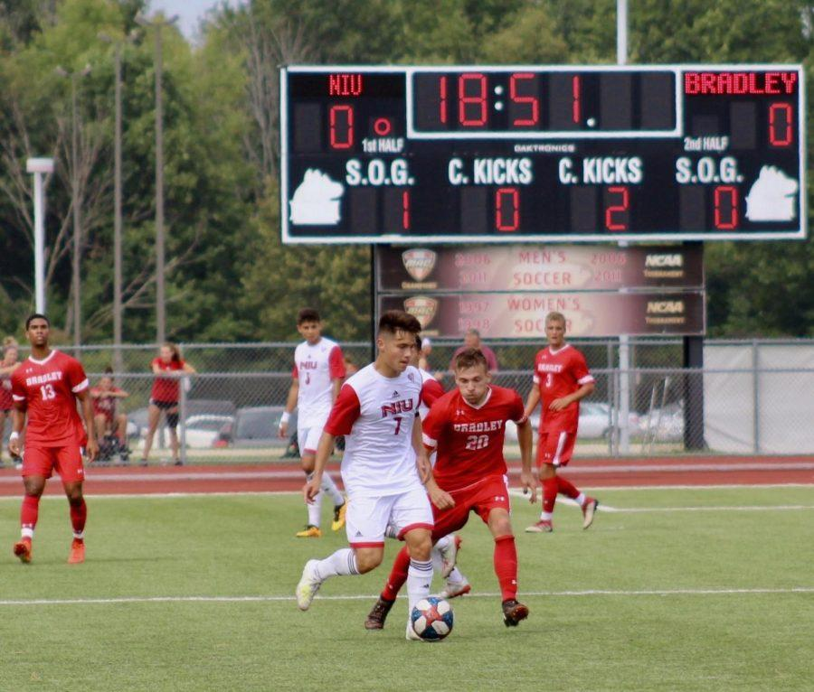 Junior midfielder Alex Welch positions himself for a pass as an opponent provides pressure Sept. 15 against Bradley University in a 2-1 home win.