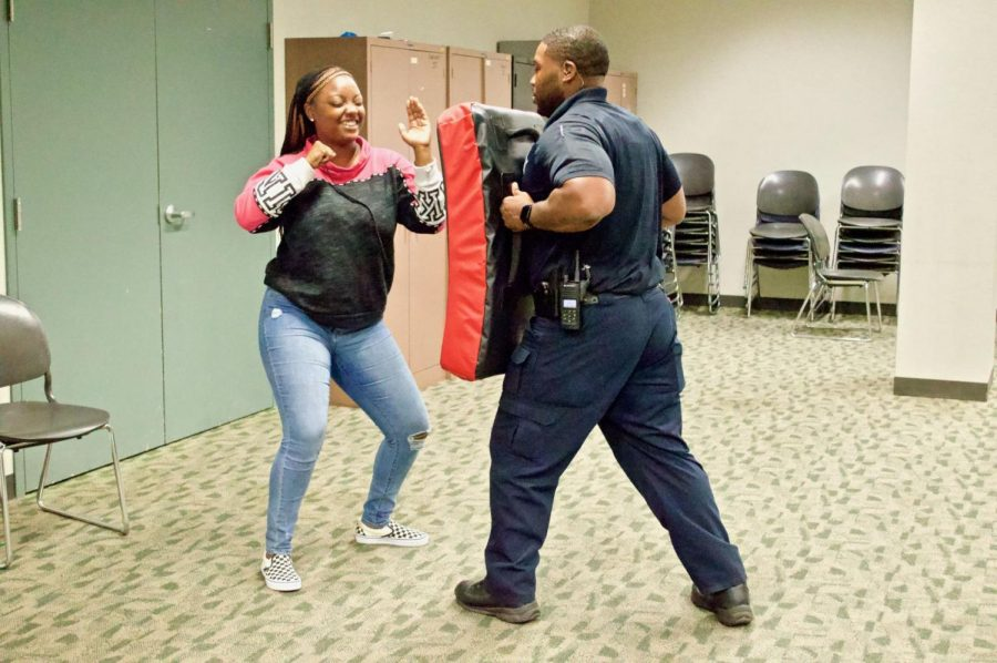 Taquori Nalliburton, senior non-profit and NGO studies major, practices self-defense moves Thursday at Stevenson South.