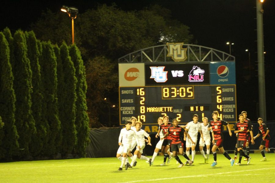 Men's soccer defends a cross Sept. 13 in a match against Marquette University in an eventual 3-1 loss by NIU.