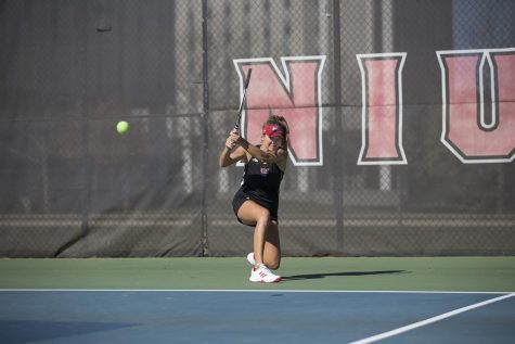 Sophomore Fernanda Naves follows though on her swing during a 2018 match.