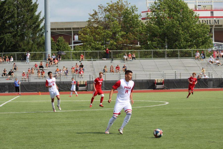First-year defender Adrian Lara moves the ball downfield Sunday at home against Bradley University.