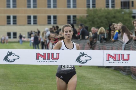 Junior runner Ashley Tutt approaches the finish line to take first place Friday at the Huskie Challenge.