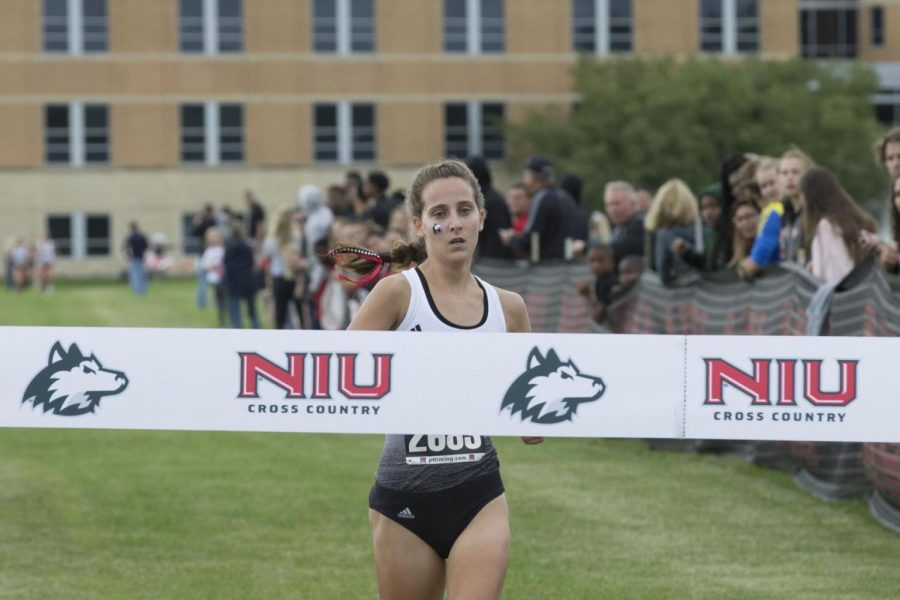 Junior runner Ashley Tutt approaches the finish line to take first place Sept. 11 at the Huskie Challenge.
