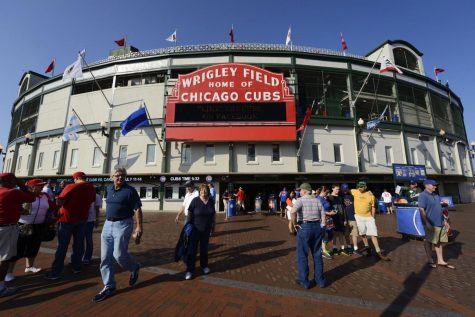 Chicago, USA- July 10,2013: Wrigley Field Stadium - Home of Chicago Cubs - major league baseball team of Chicago and people waiting in line in front of it. Wrigley Field is one of the oldest baseball fields in the country.