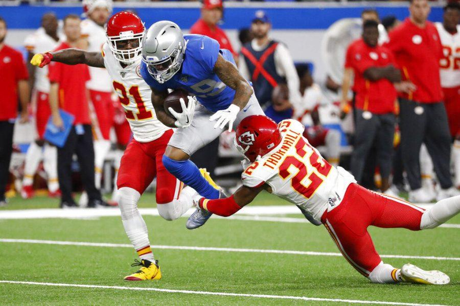 Detroit+Lions+wide+receiver+Kenny+Golladay+%2819%29+is+tackled+by+Kansas+City+Chiefs+free+safety+Juan+Thornhill+%2822%29+during+the+first+half+of+an+NFL+football+game%2C+Sunday%2C+Sept.+29%2C+2019%2C+in+Detroit.+%28AP+Photo%2FRick+Osentoski%29