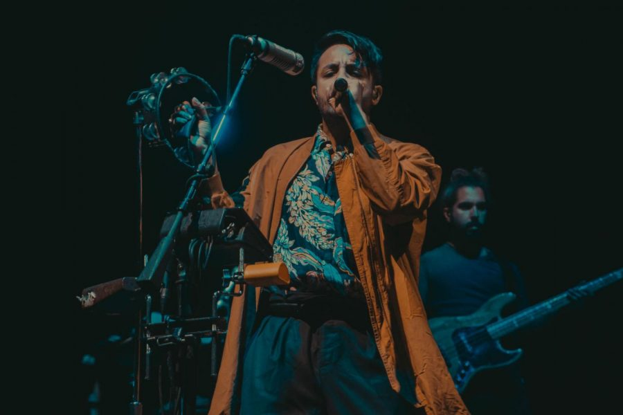 Young the Giant frontman Sameer Gadhia performs before a crowd Friday at the Convocation Center. Young the Giant performed as part of NIU's Homecoming events.
