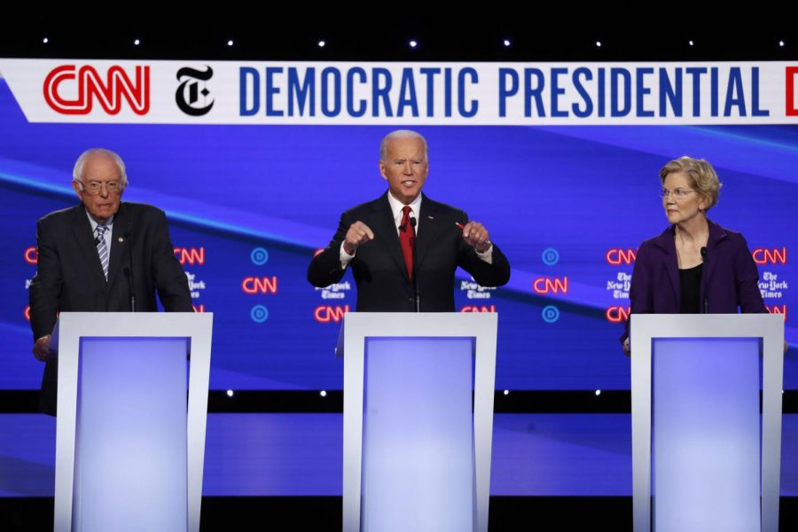 Democratic presidential candidates Sen. Bernie Sanders (from left), former Vice President Joe Biden and Sen. Elizabeth Warren participate Tuesday in a Democratic presidential primary debate in Ohio.
