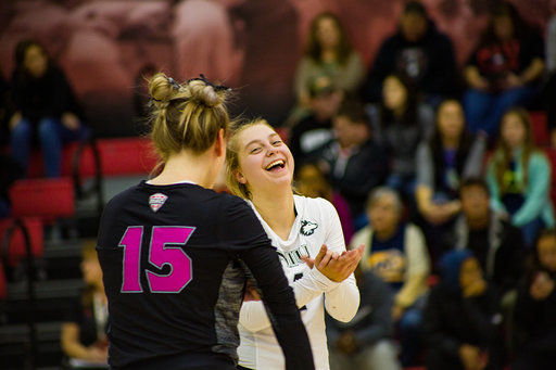 Senior setter Amanda Krahl (left), has a word with junior libero Miranda Karlen Friday during an eventual 3-1 victory against Kent State University at Victor E. Court.