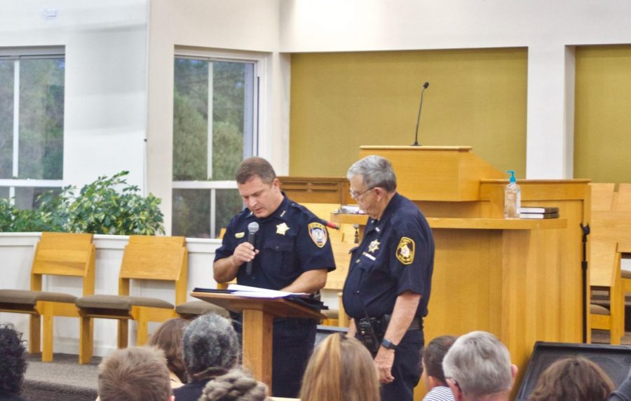 In this Sept. 4 photo, Interim Police Chief John Petragallo (left) speaks about an arrest statistics website at the New Hope Missionary Baptist Church, 1201 Twombly Rd.