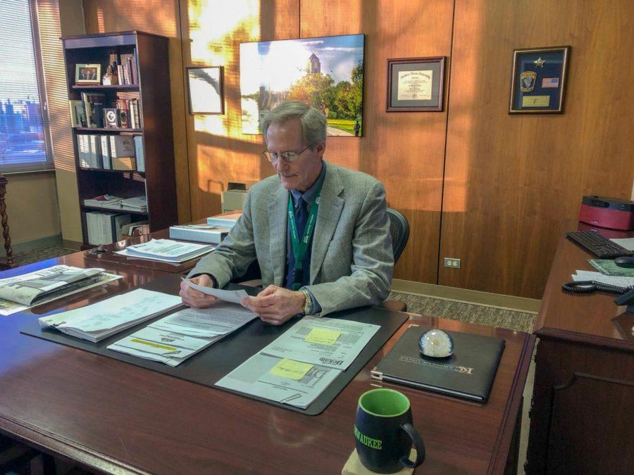 In this Jan. 14 photo, DeKalb City Manager Bill Nicklas sits at his desk and reviews documents after stepping into the position.
