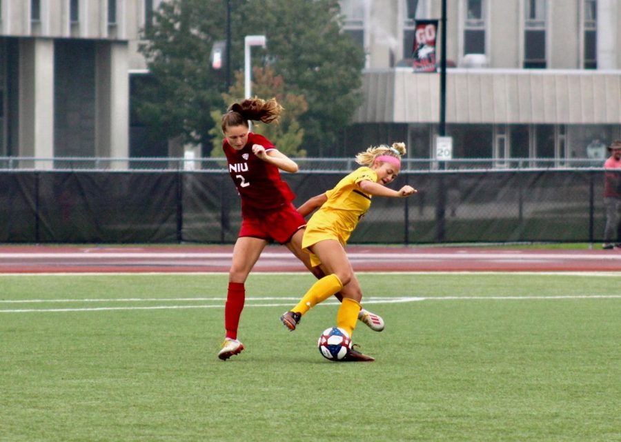 Junior defender Lauren Neslund pressure an opponent Sept. 29 during an eventual 1-0 loss to Kent State University at the Soccer and Track and Field Complex in DeKalb.