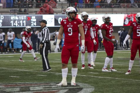 Junior defensive end Matt Lorbeck awaits pre snap Saturday as the defense looks to its coaches for the next call during NIU's 49-0 win against Akron at Huskie Stadium.