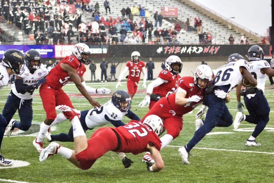 Corey+Lersch%2C+redshirt+junior+tight+end%2C+makes+a+tackle+on+special+teams+against+an+Akron+return+specialist+Saturday+during+NIU%27s+49-0+victory+at+Huskie+Stadium.