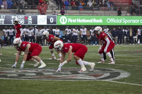 Redshirt Sophomore linebackerVinny Labus (50) and Nick Rattin, first-year linebacker Nick Rattin (38) prepare for an Akron snap Saturday during NIU's 49-0 victory at Huskie Stadium.