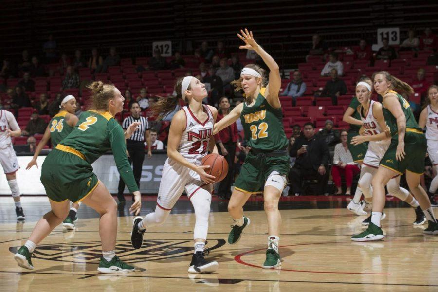 Senior guard Mikayla Voigt drives to the net Nov. 28 during a home match against South Dakota State University at the Convocation Center.