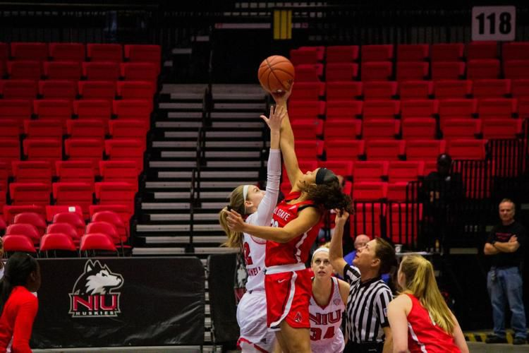 Junior Forward Riley Blackwell goes up for a jump ball March 6 during NIU's 67-64 defeat to Ball State University at the Convocation Center.