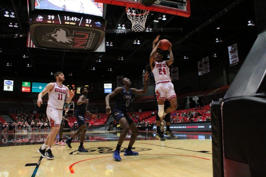 Sophomore guard Darius Beane drives to the basket Monday during NIUs 65-48 victory against Longwood University at the Convocation Center.
