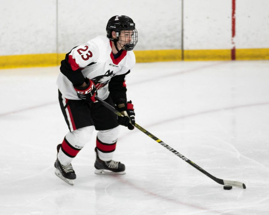 First-year forward Rodahn Evans keeps the puck close Sept. 27 during NIU's 3-2 loss to Western Michigan University at the Canlan Ice Center in West Dundee.