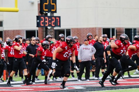 The Huskies run onto the field Oct. 5 at Huskie Stadium before a game against Ball State University.