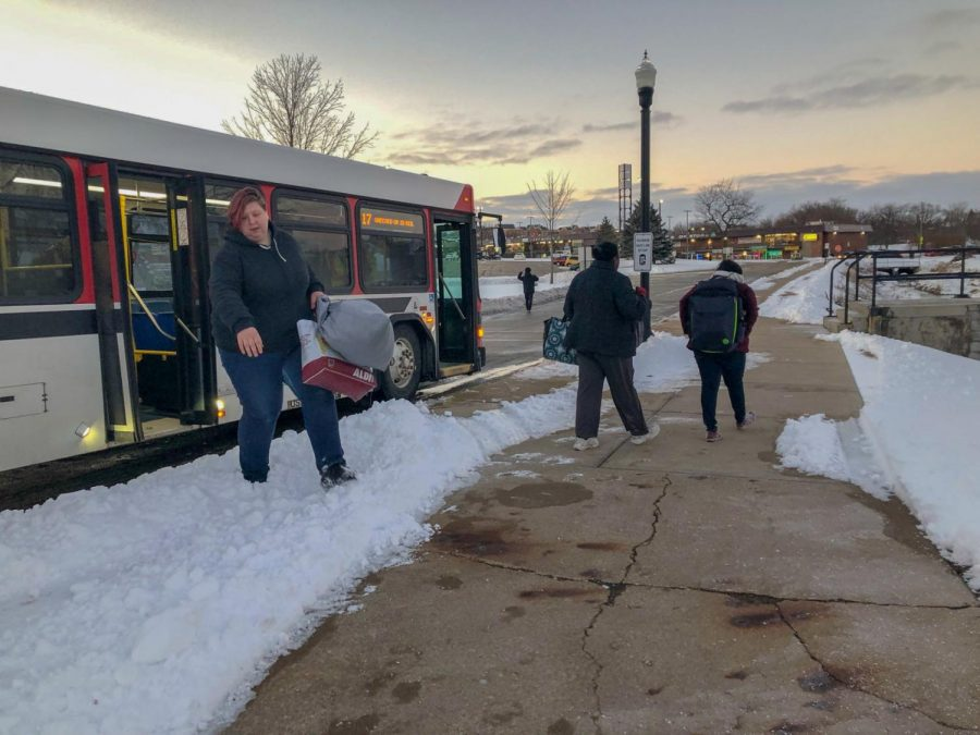 Individuals take advantage of the HuskieLine route 17 bus Sunday afternoon near the DuSable turn around. As of Jan. 1 changes to routes 16, 17 and 18 have been implemented.