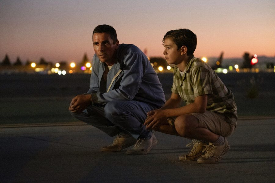 Ken Miles, played by Christian Bale, (Left) and his son Peter, played by Noah Jupe, spend time talking about racing in