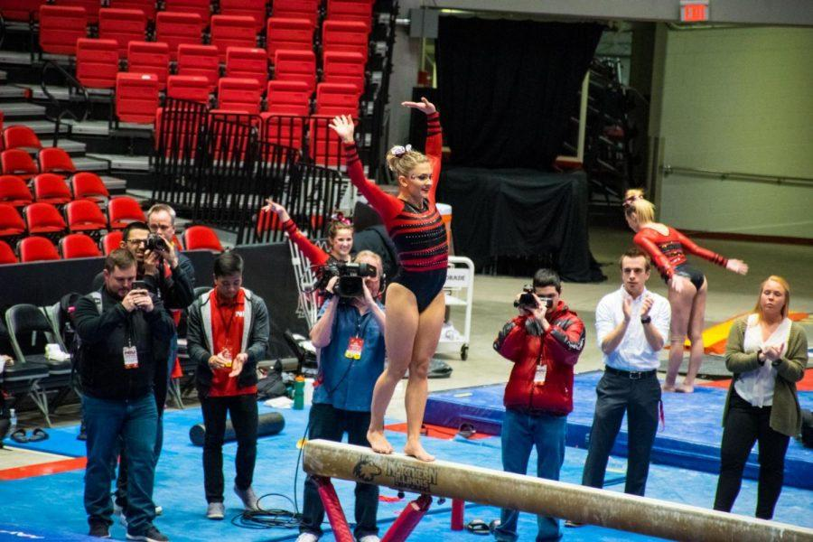 Alumna+Anna+Martucci+performs+her+routine+on+the+beam+March+28+during+NIU%27s+the+Beauty+and+the+Beast+competition+at+the+Convocation+Center.