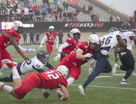 Corey Lersch, redshirt junior tight end, makes a tackle on special teams Oct. 26 during NIU's 49-0 victory against the University of Akron at Huskie Stadium.