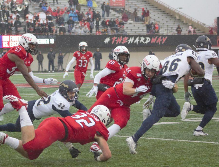 Corey+Lersch%2C+redshirt+junior+tight+end%2C+makes+a+tackle+on+special+teams+Oct.+26+during+NIU%27s+49-0+victory+against+the+University+of+Akron+at+Huskie+Stadium.