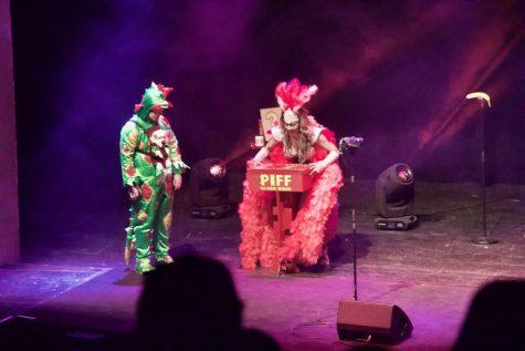 Piff the Magic Dragon (left) and dancer Jade Simone prepare for Piff's magic act.