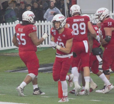 Huskies celebrate after a touchdown Oct. 26 during NIU's 49-0 victory against University of Akron at Huskie Stadium.