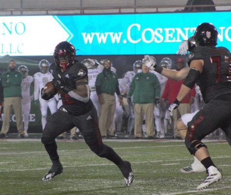 Tre Harbison, redshirt junior running back, wins the edge on a run Tuesday during NIU's home loss against Eastern Michigan University at Huskie Stadium.