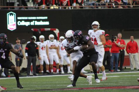Daniel Crawford, redshirt senior tight end, muscles away an opponent Aug. 31 2019after a catch against Illinois State University during NIU's 24-10 victory at Huskie Stadium.