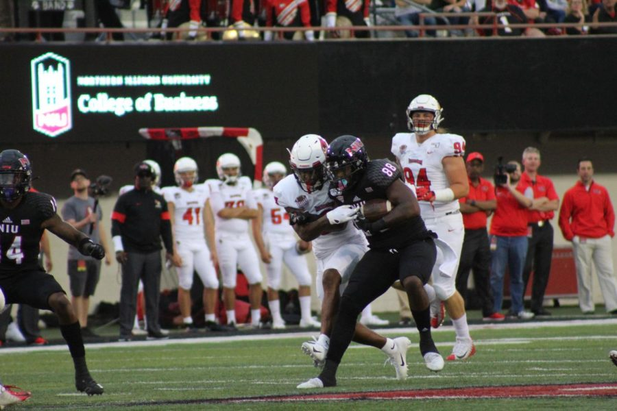 Daniel+Crawford%2C+redshirt+senior+tight+end%2C+muscles+away+an+opponent+Aug.+31+2019%C2%A0after+a+catch+against+Illinois+State+University+during+NIU%27s+24-10+victory+at+Huskie+Stadium.